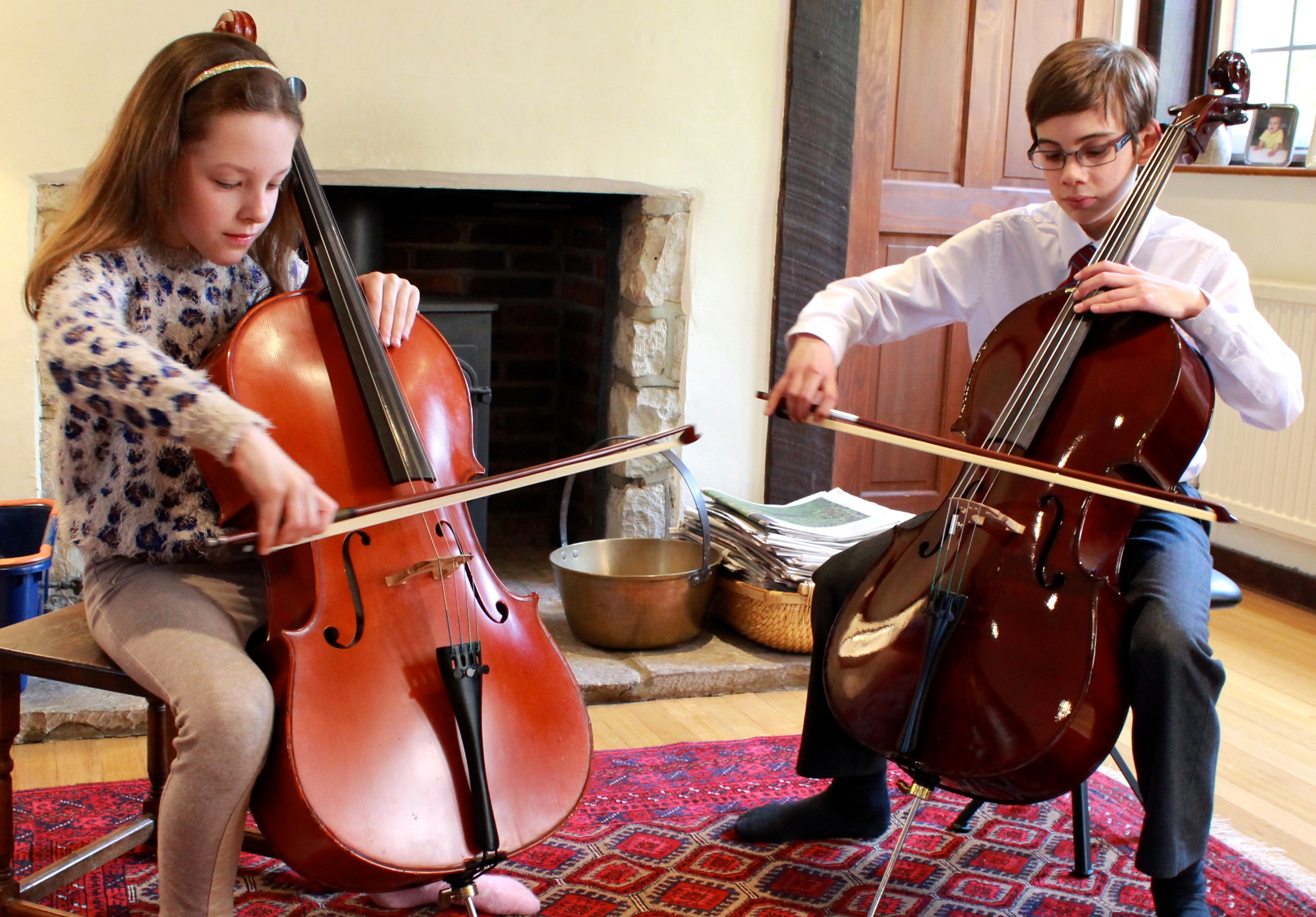 boy and girl playing Cello